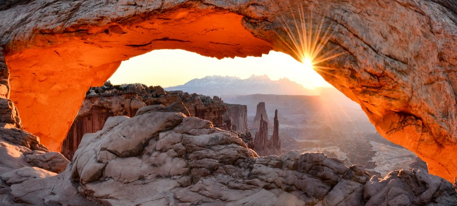 Mesa Arch Sunrise. Panorama capturing the reflective glow of first light on the underside of Mesa...