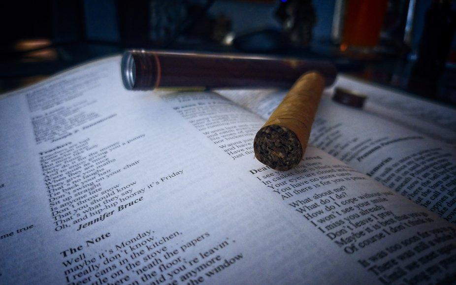 Still life cigar on poetry book