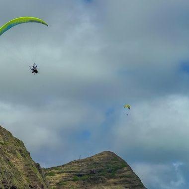 Two Hang Gliders flying over Makapu'u Beach, East Honolulu, Hawaii
