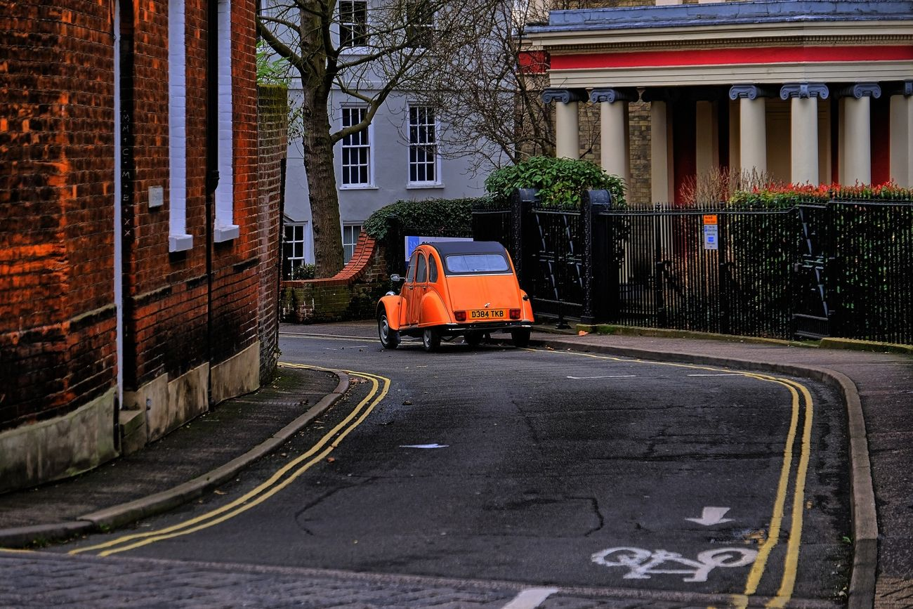 I was walking through the city streets of Norwich England, when I came across this Bright orange Car.