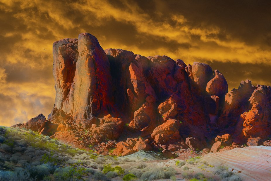 "As the sun sets in Nevada's ""Valley Of Fire"", the last rays illuminate..."