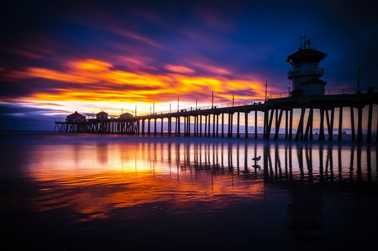Huntington Beach Pier under a burning sky