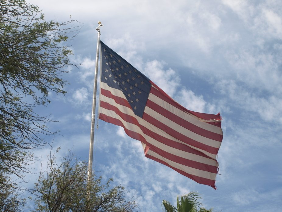One of my pet peeves is to see big American flags flying over businesses that  are tattered, unli...