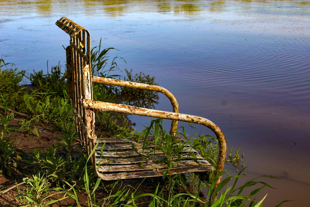We were on Photo Club outing and I saw this chair on the bank of the Red River
