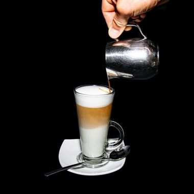 the pouring of a floating latte coffee by me