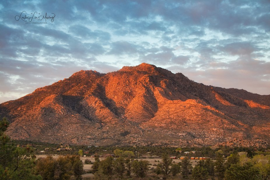 The Sunrise and the Storm just make for a beautiful example of how Majestic Granite Mountain trul...