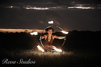 My girl my love. An astounding and beautiful talent. Ebonie with one of her fire hoops