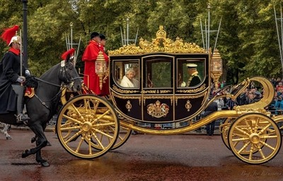 Queen Elizabeth II, Prince Charles and Camilla leave Buckingham Palace by the Queen's golden carriage.  The Queen was addressing Parliament later in the morning.