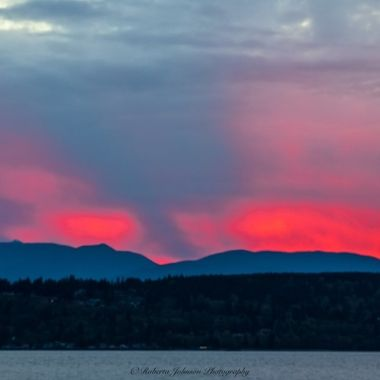 What an amazing afterglow to the sky. The color was out of this world unreal!  Hood Canal, Washington, USA