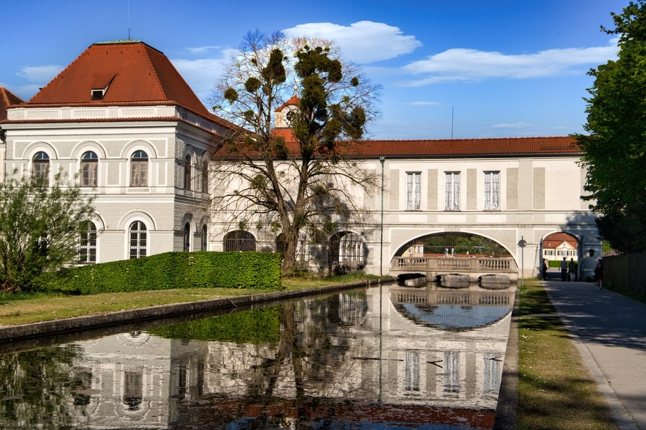 A beautiful reflection in one of the waterways in the gardens of Schloss Nymphenburg (Nymphenburg...