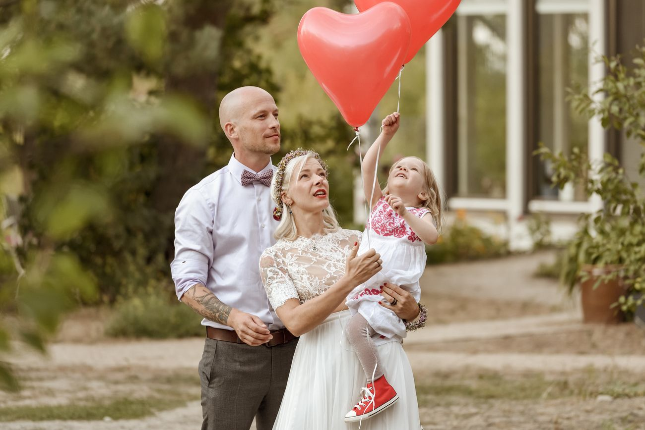 wedding-young couple with a child after wedding ceremony celebrate love