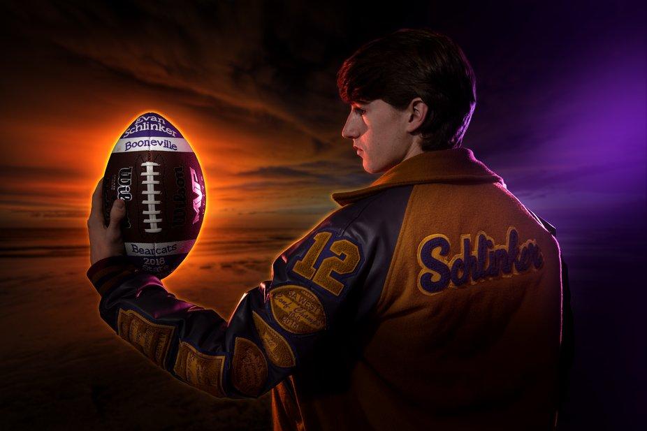 Senior guy football athlete with letter jacket.