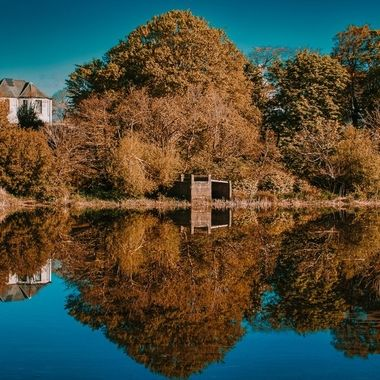 Scenic view of Old House and reflected threes