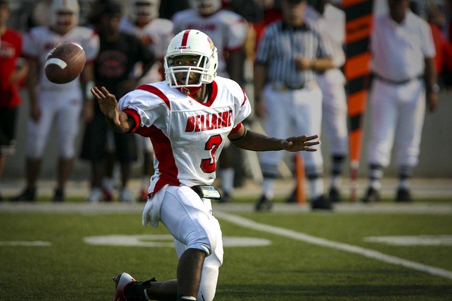 High school quarterback pitches the ball