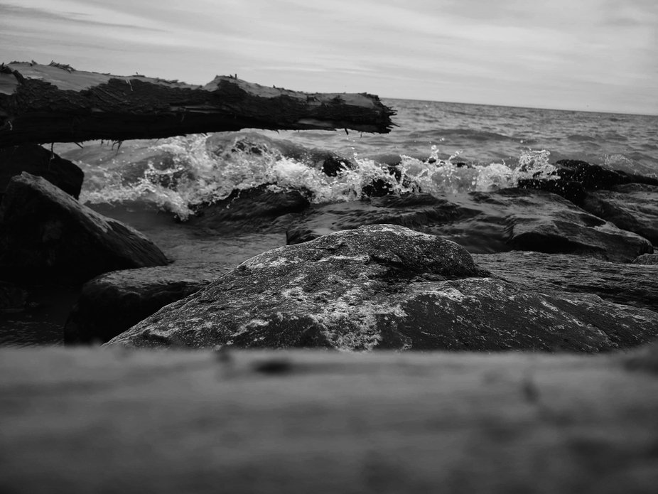 Small Waves Crash Into the Rocks B&W