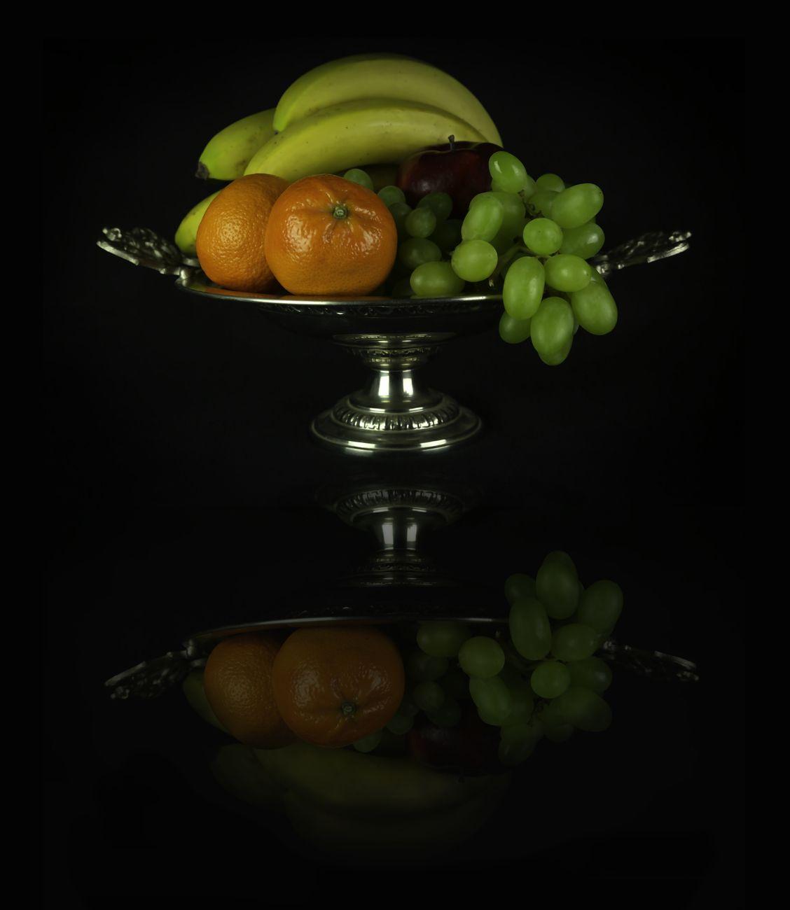 Still life fruit reflecting