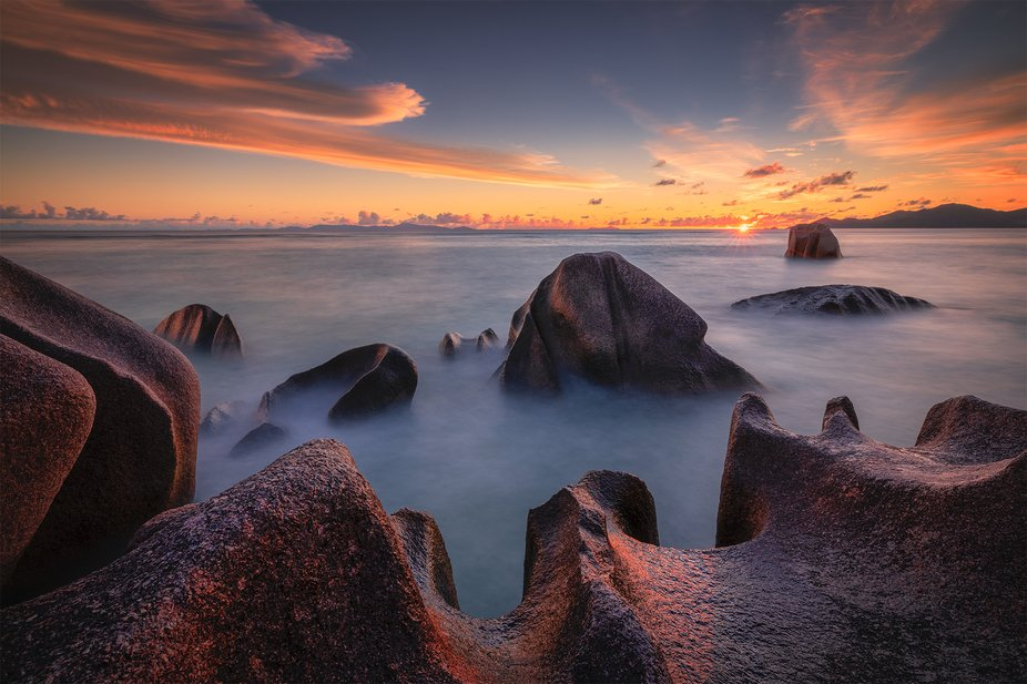 Beautiful sunset at Anse Source d'Argent beach on la Digue in Seychelles.