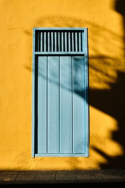 Beautiful lightblue door in Havana, Cuba with a complimentary yellow wall