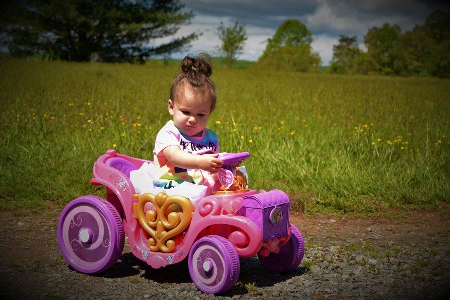 Grand baby in her princess car