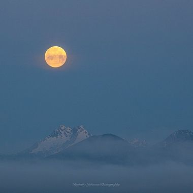 The Moon setting with the Olympic Mountains, Hood Canal, Washington, USA