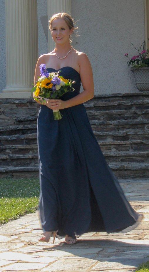A capture of a bridesmaid in an outdoor wedding