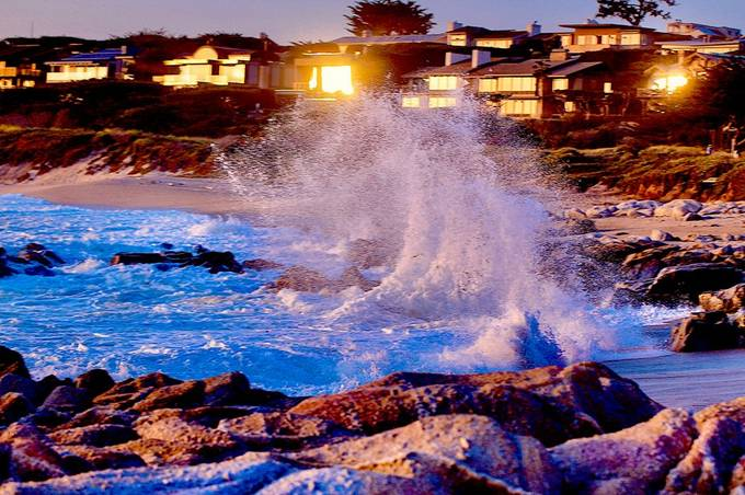 Crashing Waves Burst aglow from the reflected sunlight slong the Pacific Coast near Carmel Ca