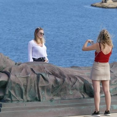 Tourists at WWII war memorial