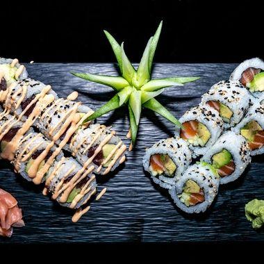 a selection of salmon california sushi rolls and spicy tuna california sushi rolls with a spicy mayo dressing