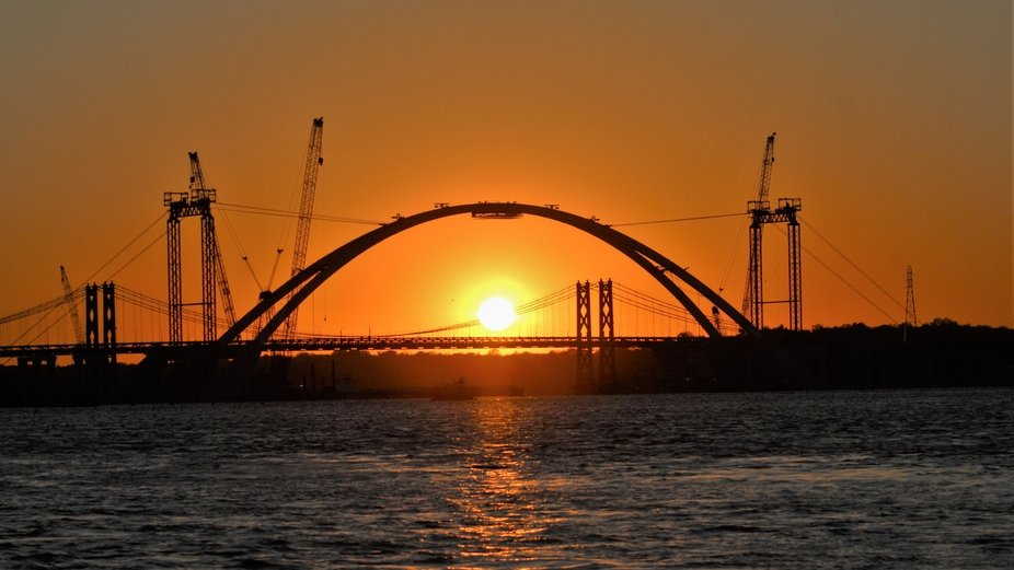 Sunset under the first set of arches for the new I74 river bridge which crosses the Mississippi r...