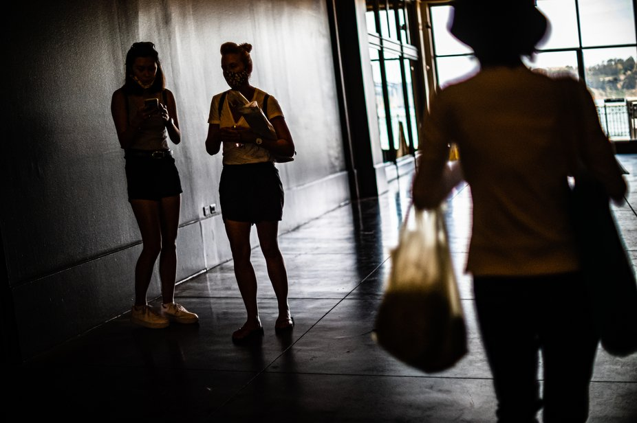 Shopping during Corona virus in San Francisco in April, 2020. Various mask usages in this image. ...