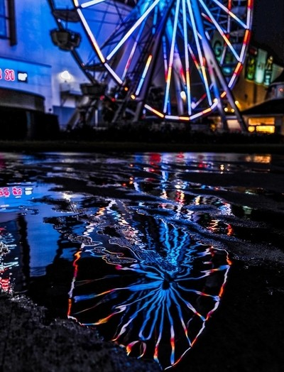 Ferris Wheel Reflection in Water at Night