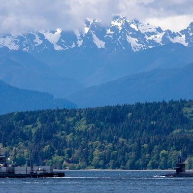 Submarine with escorts returning home. Thank you for serving the United States of America! Hood Canal, Washington, USA