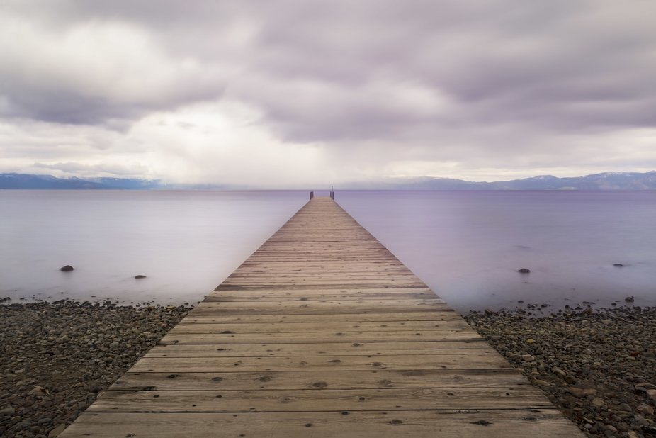 Long exposure of a dock on Lake Tahoe before an approaching storm