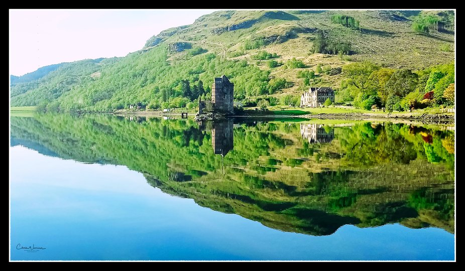 Carrick Castle, an impressive old tower house in a pretty spot on the banks of Loch Goil, long he...