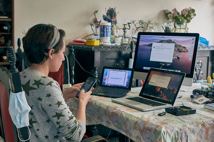 Young woman working from home in technical service. Computer Support.