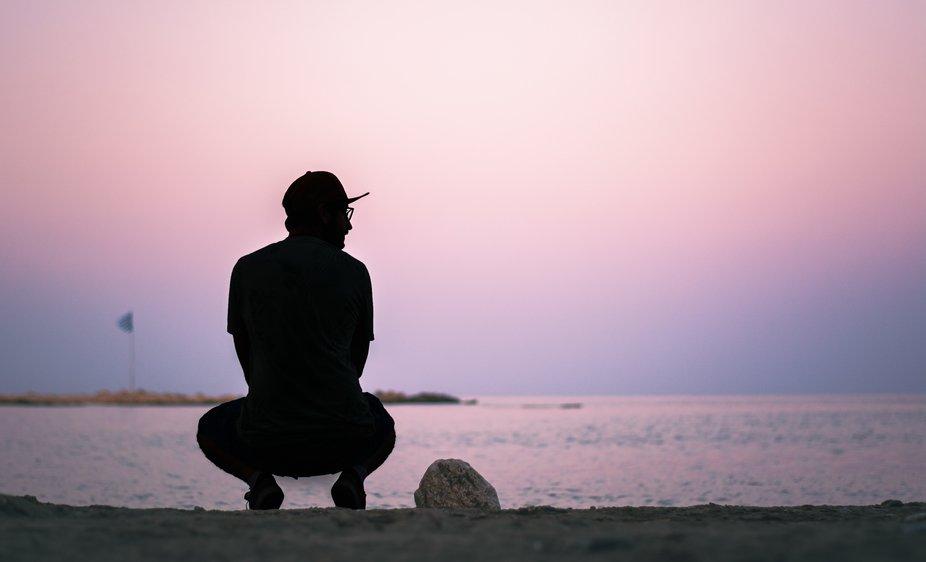 Man on the beach at dusk