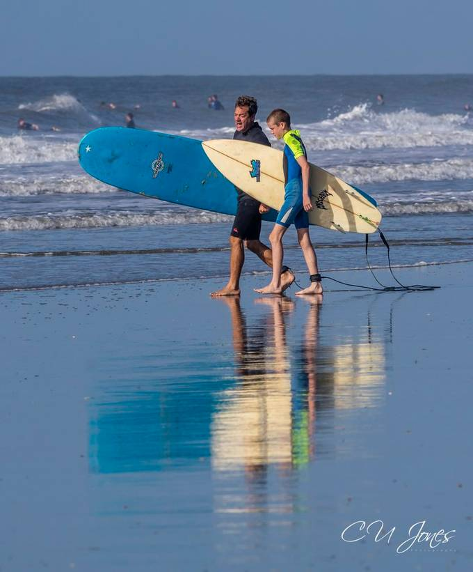 Surfers of Folly Beach. Father and Son time surfing