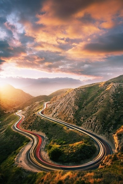 Sunset Over Curved California Road