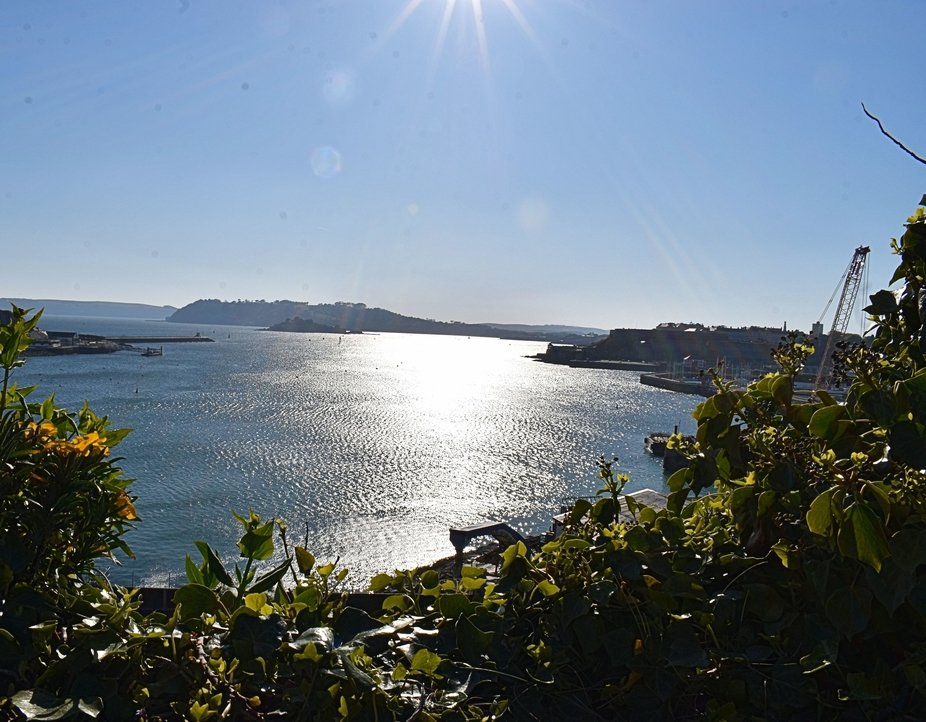 The sun shining over Plymouth Sound