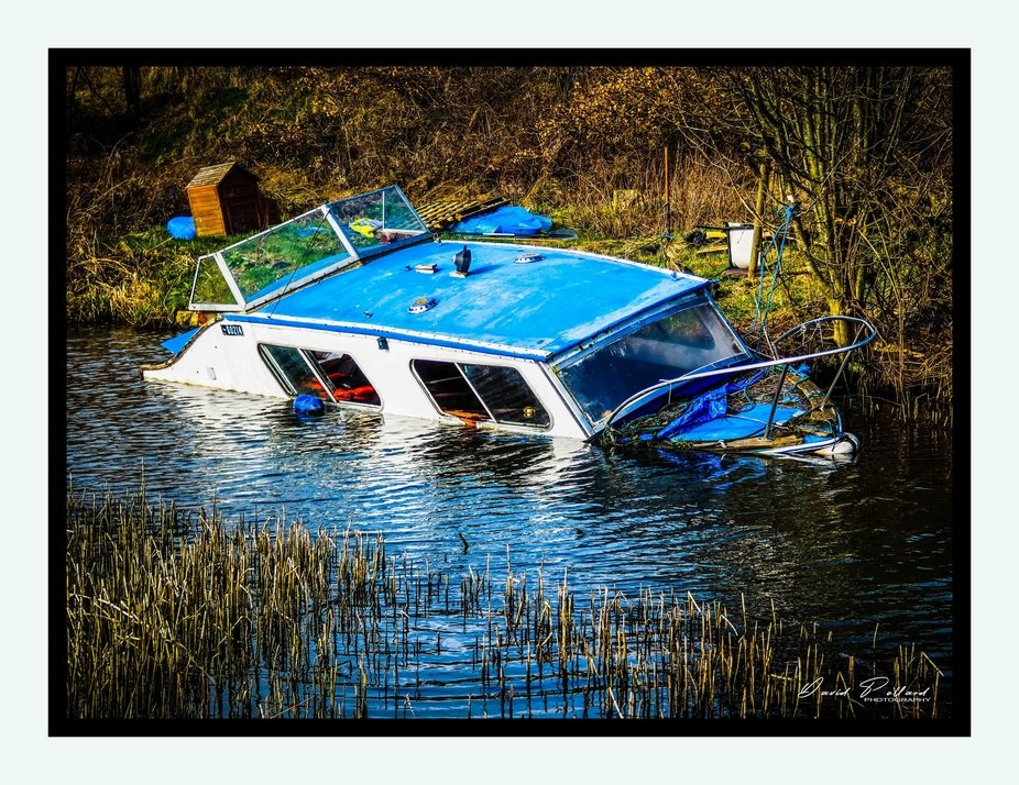 Sinking boat on the Huddersfield canal