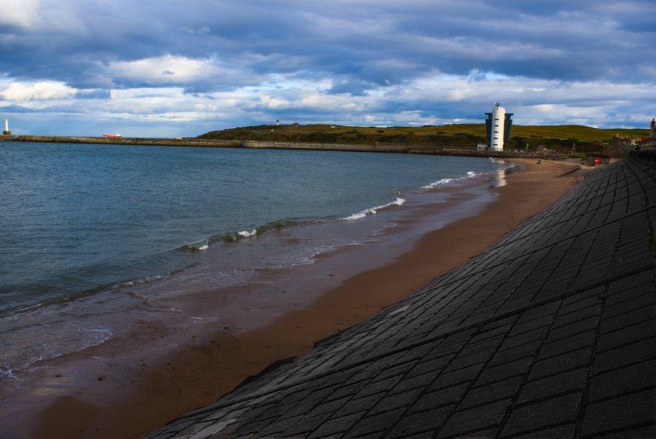 A long shot of the Marine Operations centre on Aberdeen beach, Nigg lighthouse and Aberdeen light...