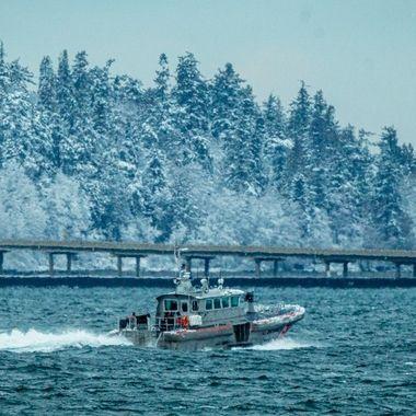 Coast guard boat escorting a Submarine. Hood Canal, Washington, USA