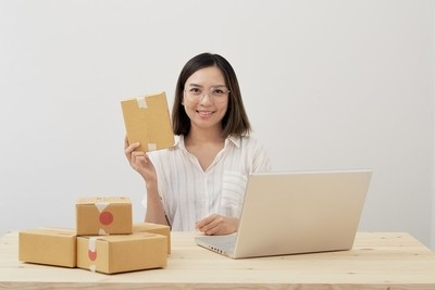 Asian business women selling items at home