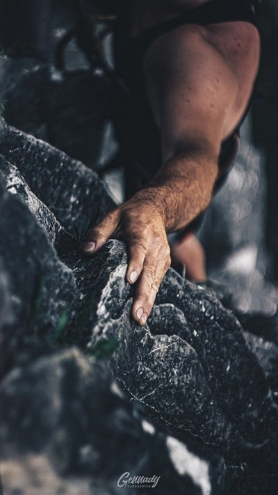 The hand on a rock