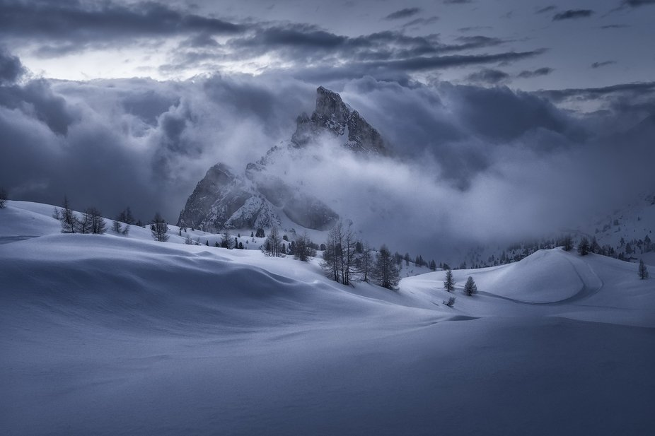 A cloudy and snowy sunset suddenly turned in a great mood and light, revealing the Sass de Stria ...