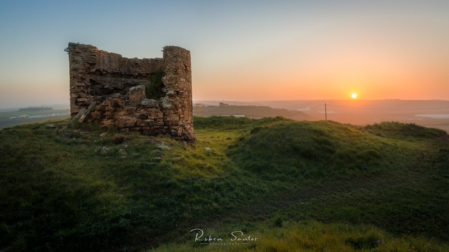 Sunset near the fort number 111, originally used as a windmill and converted as a military storeh...