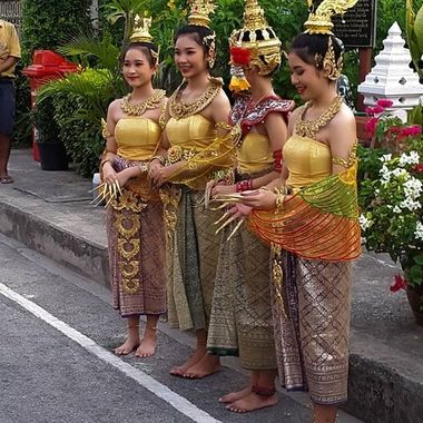 Thai ladies doing a Traditional dance in our street....