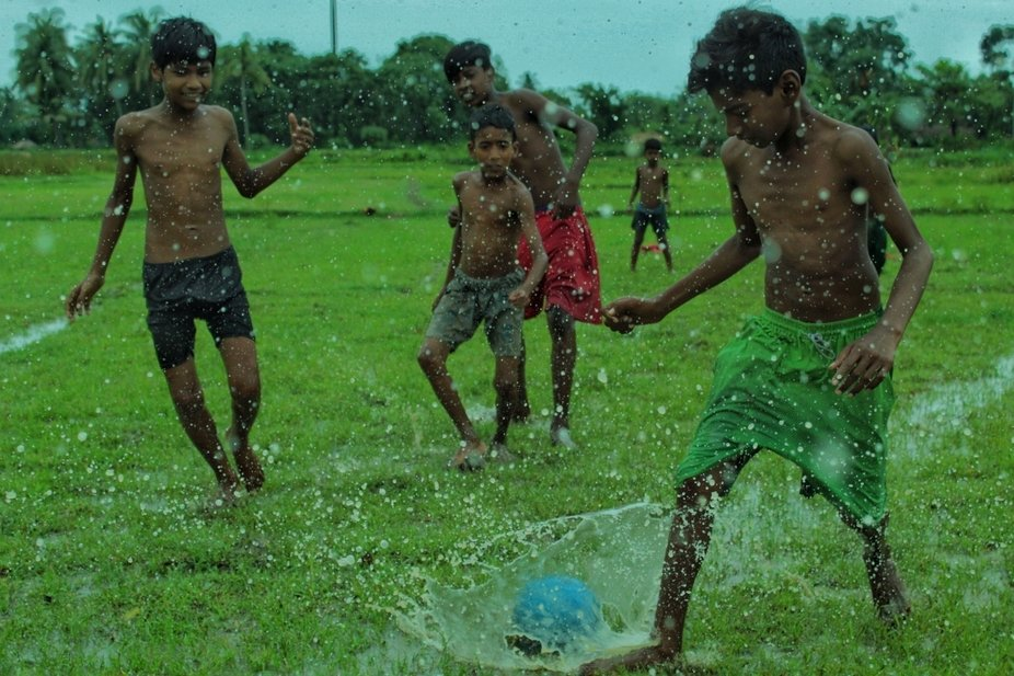 Children's are playing football in Rainyday