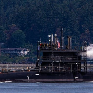I saw this Submarine this afternoon and am not sure how to caption it. I believe it is being moved from one location to another for maintenance but I see our sailors on deck and would like to thank them for all the sacrifices they make for us. We can not thank you enough. God Bless you and God Bless the United States of America! Hood Canal, Washington, USA