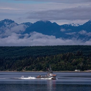 Coast Guard boat  with the Olympic Mountains. I love the beauty of the PNW <3